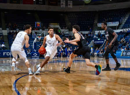 Falcons forward Ryan Swan (34) moves down the court in the second half of the game versus San Diego State on Saturday, January 12, at Clune Arena in Colorado Springs. Swan added 15 points to the Falcon's score, helping them defeat the Aztecs 62-48. (photo by Liz Copan)